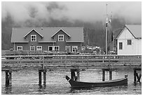 Pier and waterfront buildings, Tofino. Vancouver Island, British Columbia, Canada ( black and white)