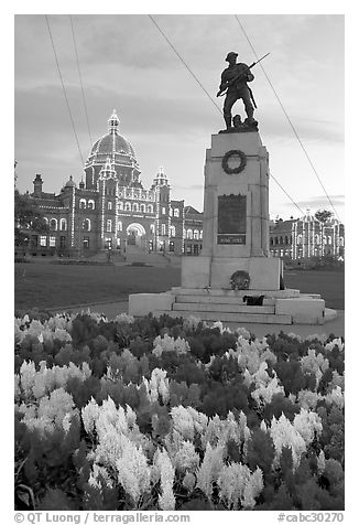 Flowers, memorial, and illuminated parliament. Victoria, British Columbia, Canada (black and white)