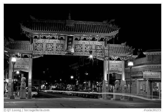 Gate of Harmonious Interest marking the entrance of Chinatown, night. Victoria, British Columbia, Canada (black and white)