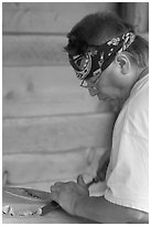 Artist carving a totem pole. Butchart Gardens, Victoria, British Columbia, Canada (black and white)
