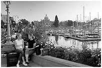 Young Women sitting, Inner harbor. Victoria, British Columbia, Canada ( black and white)