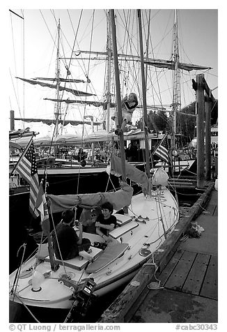 Kids in a small sailboat docked in Inner Habor. Victoria, British Columbia, Canada (black and white)