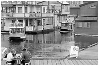 Harbor ferries and outdoor eatery, Upper Harbor. Victoria, British Columbia, Canada ( black and white)