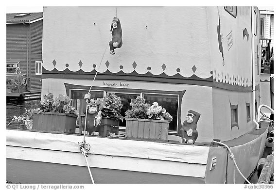 Houseboat decorated with a monkey theme. Victoria, British Columbia, Canada (black and white)