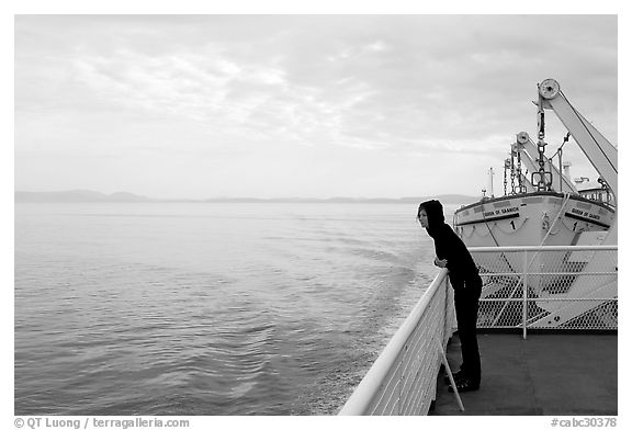 Woman looking out from deck of ferry. Vancouver Island, British Columbia, Canada (black and white)