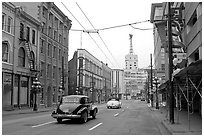 Street in Gastown with two old cars. Vancouver, British Columbia, Canada (black and white)