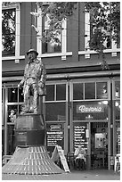 Statue and cafe in Gastown. Vancouver, British Columbia, Canada (black and white)