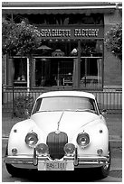 Classic car in front of Spaghetti Factory restaurant. Vancouver, British Columbia, Canada (black and white)