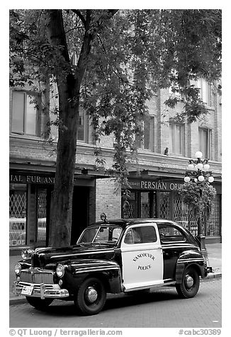 Old Police car in Water Street. Vancouver, British Columbia, Canada (black and white)