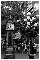 Tourists watch steam clock in Water Street. Vancouver, British Columbia, Canada (black and white)