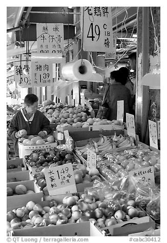 Fruit store in Chinatown. Some of the tropical fruit cannot be imported to the US. Vancouver, British Columbia, Canada (black and white)
