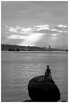 Girl in wetsuit statue, sunrise, Stanley Park. Vancouver, British Columbia, Canada (black and white)