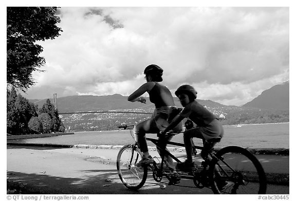 Tandem bicyclist on the trail around Stanley Park. Vancouver, British Columbia, Canada (black and white)