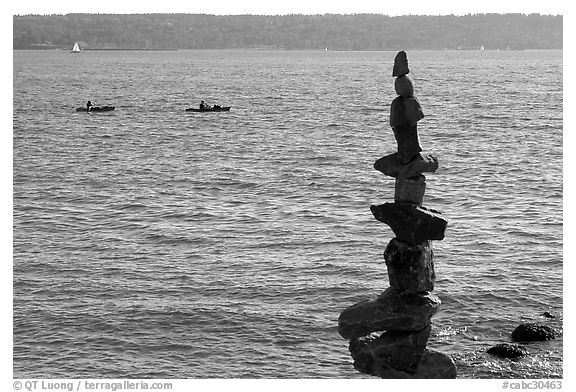 Balanced rocks and kayaks in a distance. Vancouver, British Columbia, Canada (black and white)