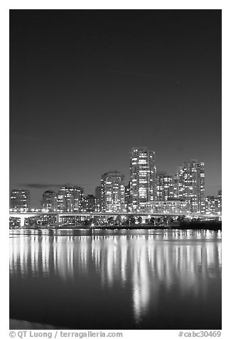 Skyline seen across False Creek at night. Vancouver, British Columbia, Canada (black and white)