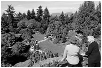 Elderly couple looking at the Sunken Garden in Queen Elizabeth Park. Vancouver, British Columbia, Canada (black and white)