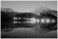Lighted cabins and mountains reflected in Emerald Lake at night. Yoho National Park, Canadian Rockies, British Columbia, Canada (black and white)