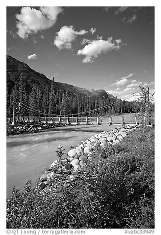 Suspension bridge crossing the Vermillion River. Kootenay National Park, Canadian Rockies, British Columbia, Canada (black and white)