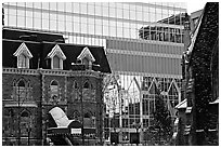 Reflection of an older building in the glass of a modern building, Montreal. Quebec, Canada ( black and white)