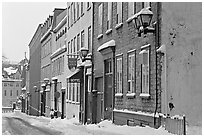 Street in winter with snow on the curb, Quebec City. Quebec, Canada ( black and white)