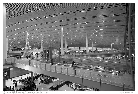 Inside main concourse at dusk, Beijing Capital International Airport. Beijing, China (black and white)