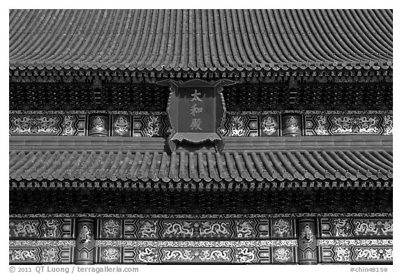 Roof detail and sign on Hall of Supreme Harmony, Forbidden City. Beijing, China (black and white)