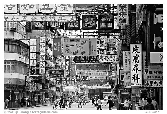 Street in Kowloon with signs in Chinese. Hong-Kong, China (black and white)