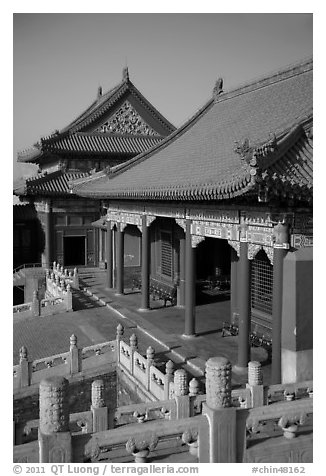 Pavilion with red columns and yellow roof tiles typical of imperial architecture, Forbidden City. Beijing, China (black and white)