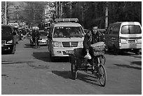 Tricycle and taxi on street. Beijing, China ( black and white)