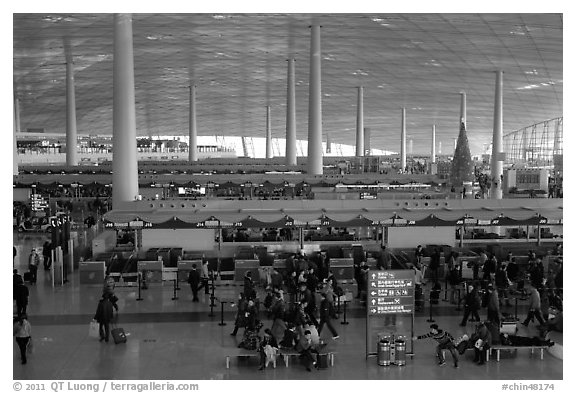 Some of the 300 check in counters, International Airport. Beijing, China (black and white)