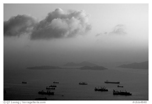 Cargo ships anchored outside of the harbor. Hong-Kong, China (black and white)