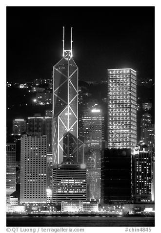 Bank of China (369m) and Cheung Kong Center (290m) buildings  across  harbor by night. Hong-Kong, China (black and white)