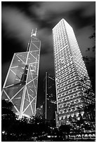 Bank of China (369m) and Cheung Kong Center (290m) buildings at night. Hong-Kong, China (black and white)