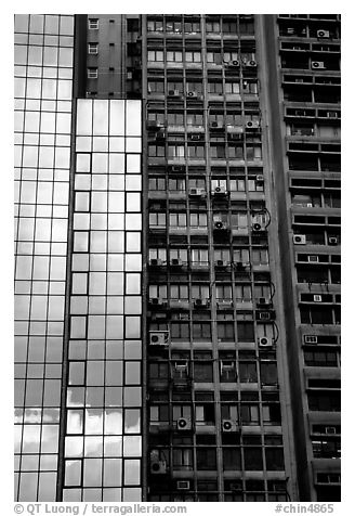 Modern building next to old  building with air conditioners, Hong-Kong Island. Hong-Kong, China (black and white)