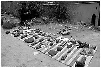 Selling strange items. Shaping, Yunnan, China ( black and white)