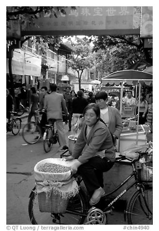 Street vendor in an old alley. Kunming, Yunnan, China (black and white)