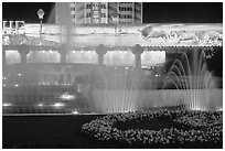 Night lights and fountains on Dongfeng Donglu. Kunming, Yunnan, China (black and white)