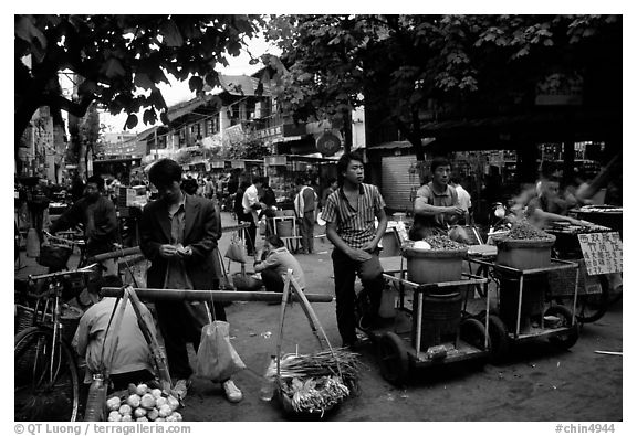 Street food vendors in an old alley. Kunming, Yunnan, China (black and white)