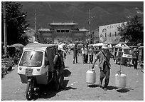 Street activity in front of the West gate. Dali, Yunnan, China (black and white)