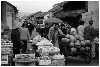 Fruits for sale on an old street. Dali, Yunnan, China (black and white)