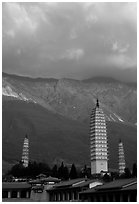 San Ta Si (Three pagodas) at sunrise with Cang Shan mountains in the background. Dali, Yunnan, China (black and white)