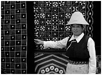 Woman in Bai dress showing drapes of traditional design. Dali, Yunnan, China ( black and white)