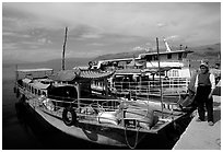 Boats on a pier of Erhai Lake. Dali, Yunnan, China ( black and white)