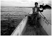 Fisherman holding a cormorant. Dali, Yunnan, China ( black and white)