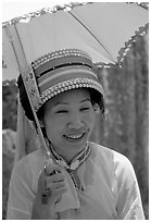 Woman from the Sani branch of the Yi tribespeople with a sun unbrella. Shilin, Yunnan, China ( black and white)