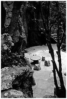 Quiet courtyard between limestone pillars. Shilin, Yunnan, China ( black and white)