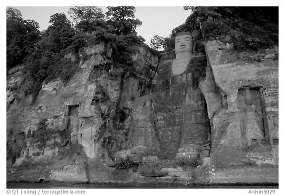 Da Fo (Grand Buddha) and two guardians seen from the river. Leshan, Sichuan, China (black and white)