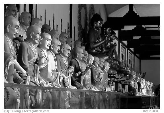 Some of the 1000 individually unique Terracotta arhat monks in Luohan Hall. Leshan, Sichuan, China (black and white)