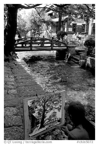 Painting a bridge. Lijiang, Yunnan, China (black and white)