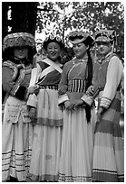 Women wearing Naxi dress. Lijiang, Yunnan, China (black and white)